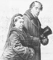Queen Victoria is walking arm in arm with Disraeli in this drawing. Disraeli is holding his hat with his other arm.