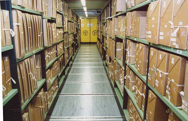 Documents on shelves at The National Archives