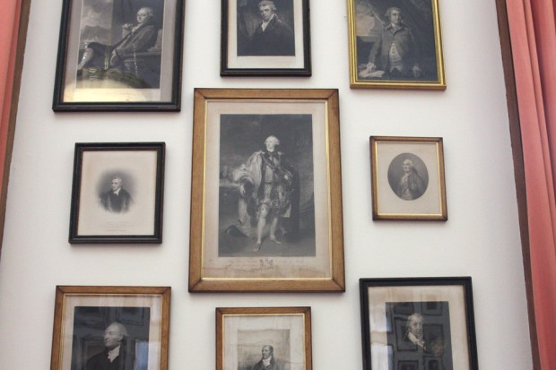 A selection of pictures of former Foreign Secretaries hanging on the wall of the Secretary of State's Private Office