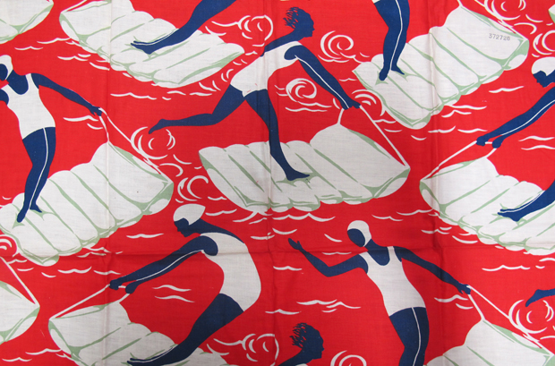 'Surfers' dress fabric; abstract images of women in various poses who are surfing on beach lilos