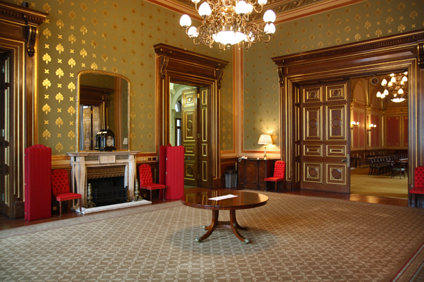 A grand room in the Foreign Office - A dining room with wall paper glistening with golden decoration and brand new carpet.