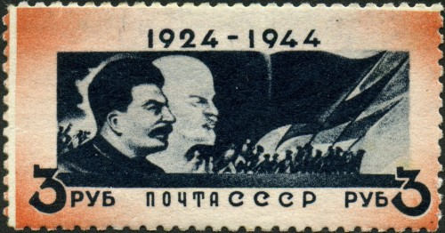 Postage Stamp, states 1924-1944. It depicts 2 men looking to the right and shadows of people waving flags