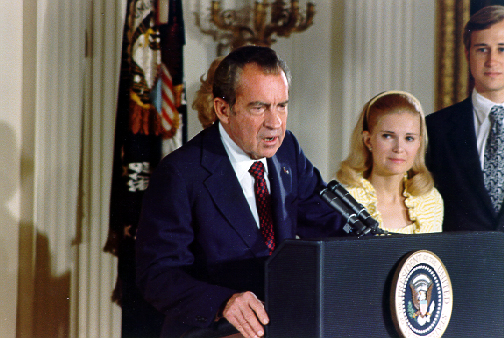 Richard Nixon at a White House podium doing a speech.