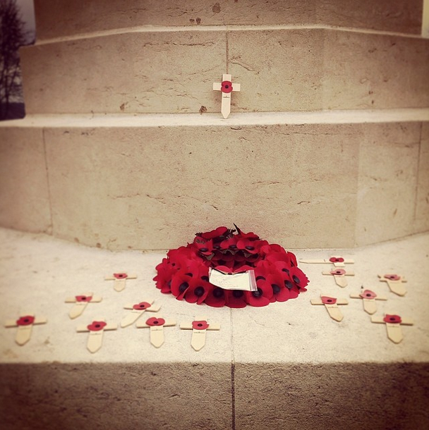 Thiepval Memorial. A wreath of poppies and several small crosses bearing poppies have been placed on the Memorial.