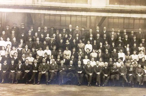 A large number of HMSO staff of the Government Forms Department at Salford seated/standing in rows for a formal photograph, circa 1916-18.