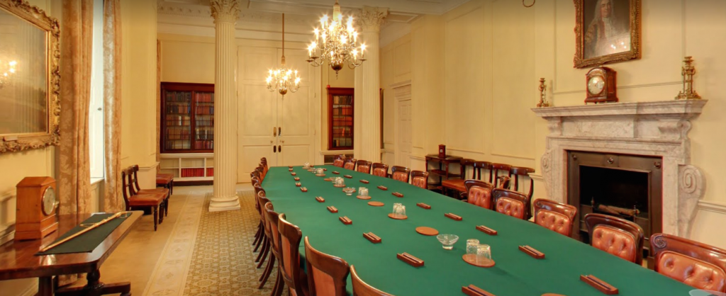 The Cabinet Room at No. 10 Downing Street is dominated by the Cabinet table with its green covering - above it is a chandelier
