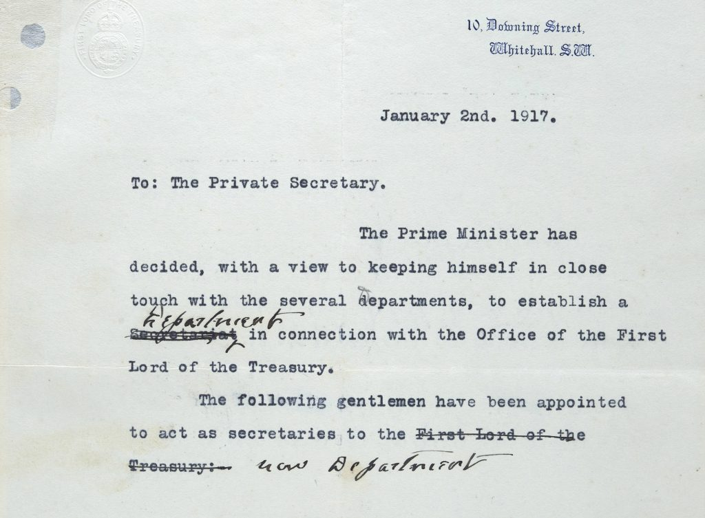 Extract of the draft note from 2 January 1917 on 10 Downing Street headed paper which reads 'To: The Private Secretary, the Prime Minister has decided, with a view to keeping himself in close touch with the several departments, to establish a ['Secretariat' is crossed out and replaced by 'Department'] in connection with Office of the First Lord of the Treasury. The following gentlemen have been appointed to act as secretaries to the ['First Lord of the Treasury' is crossed out and replaced by 'new Department']