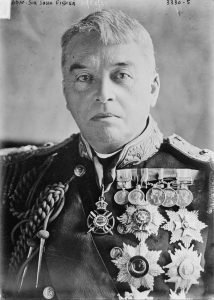 An Admiral of the Fleet posing for his portrait. He is also showing off all his medals too.