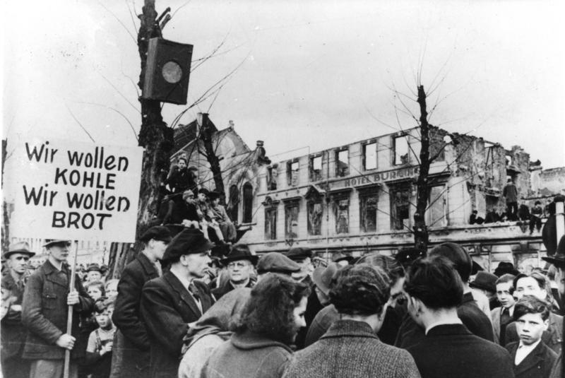 "People gather outside a burnt/ bombed hotel for a demonstration. In a protest post, it said in German ""We want coal, we want bread."" A demonstration in the city of Krefeld, North Rhine-Westphalia, Germany."