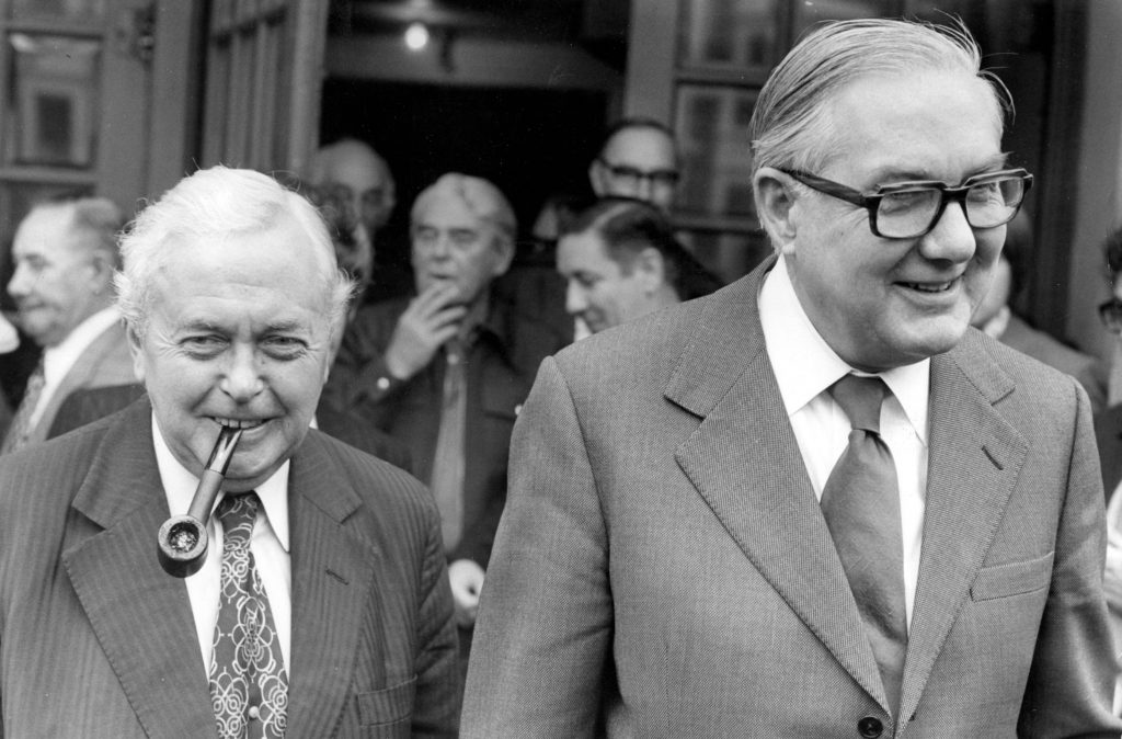 Prime Minister Harold Wilson with James Callaghan walking towards the camera. They both look happy