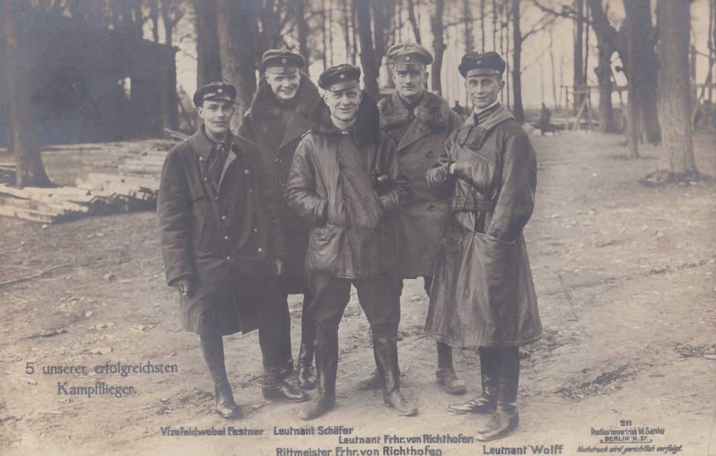 A group of men posing, the Red Baron group