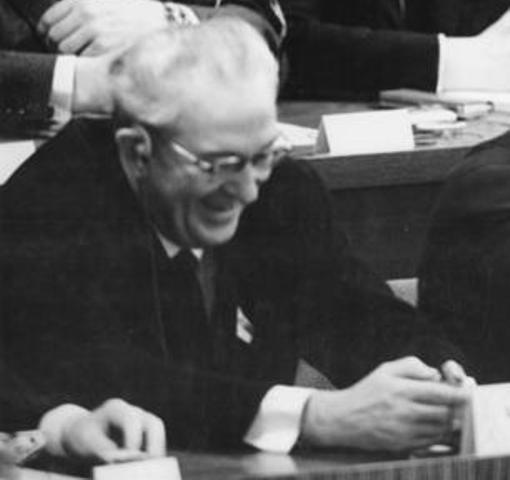 A picture of Yuri Andropov looking down and smiling