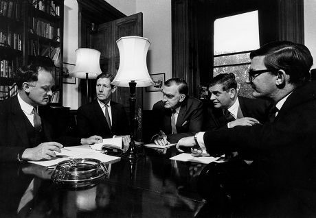 A group of officials (men in suits) in conversation