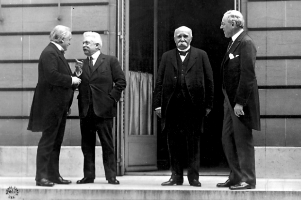 Standing in a row is Lloyd George, Vittorio Emanuele Orlando of Italy, Georges Clemenceau of France, Woodrow Wilson of the U.S