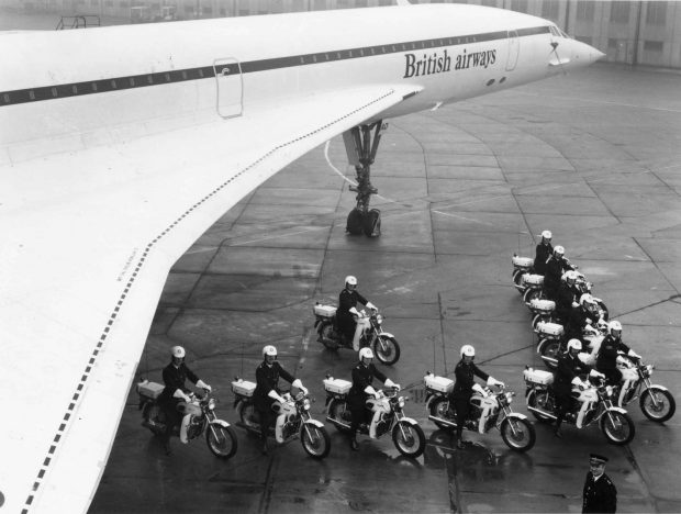 A Metropolitan Police special escort is shown in V formation, under the wing of a British Airways Concorde aircraft in 1975.