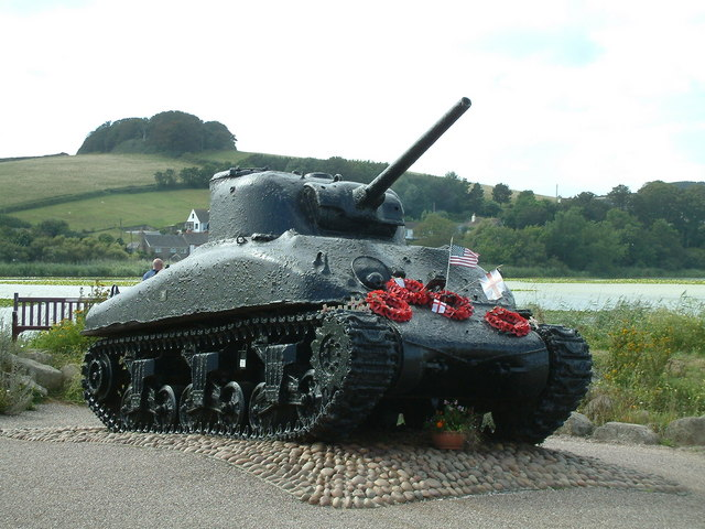 A tank abandoned as a memorial in Slapton with poppy wreaths of remembrance on it