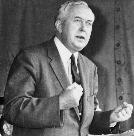 Harold Wilson (Prime Minister 1964-70. 1974-76) is shown speaking at a Mineworkers Gala. The date of the photograph is unknown but it is probably from the 1950s. Wilson is shown clenching his fists to emphasise the point he is making.