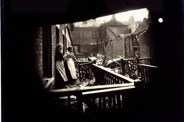 Photograph of damage caused by the raid to Edwin Place, Porter Street, Hull, 1916. Two women stand together outside a house looking upon a scene of devastation. Source: The National Archives (AIR 1/569/16/15/142)