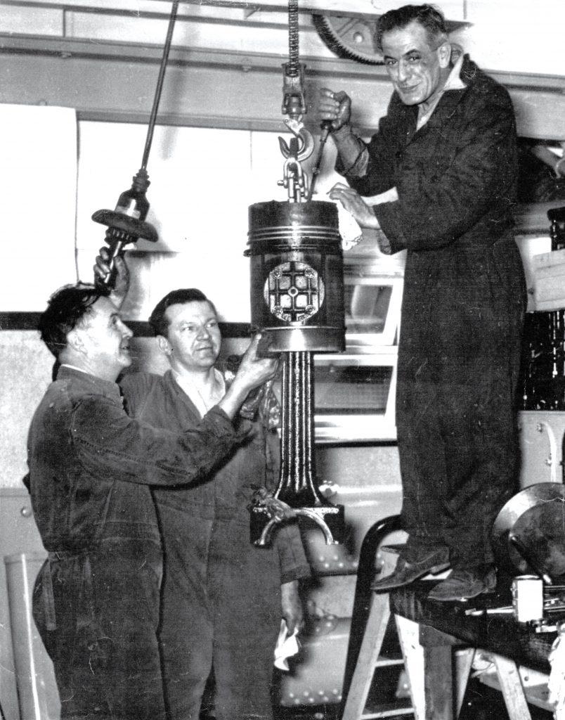 Men maintaining equipment