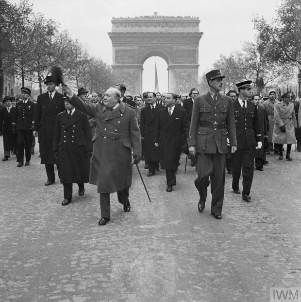 Winston Churchill leading a group of men down a pathway.