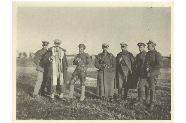 7 soldiers stood in a row, near the front line. From left to right is Unknown, Tallents, Bolshevik Officer, Harold Alexander, officers from the Baltische Landeswehr
