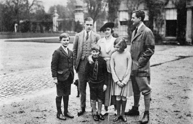 Nancy Astor in a family portrait in front of a family home.
