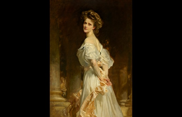 A young Nancy Astor posing with her back turned away from the painter.