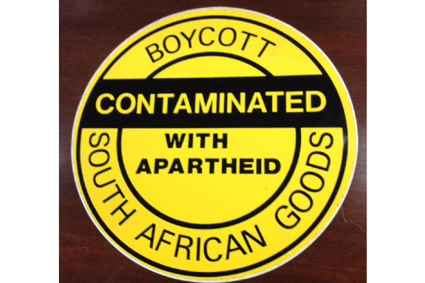 A stick saying, Boycott South African Good, Contaminated with Apartheid