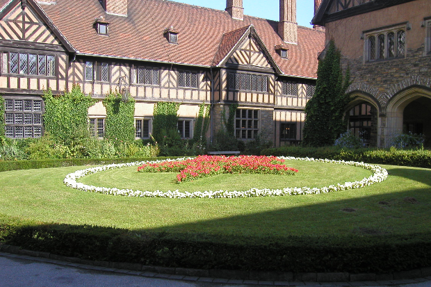 An old traditional looking house with grass patch outside, Cecilienhof Palace is a palace in Potsdam