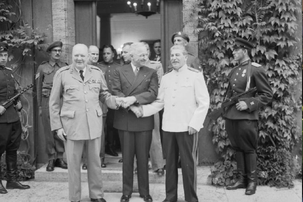 Prime Minister Churchill, President Truman and Marshal Stalin shake hands after the conference. Code-named TERMINAL this was the final Big Three meeting of the war.